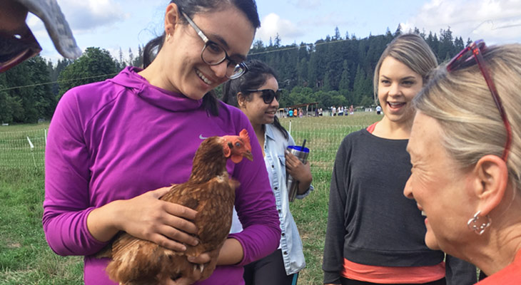 RDN program student holding chicken at farm visit