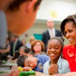 Michelle Obama with children in school cafeteria