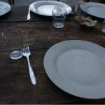 Empty dinner plate on wood table