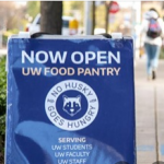 Sign saying Now Open UW Food Pantry